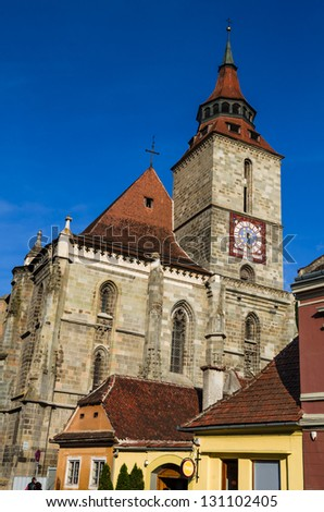 Brasov most important landmark, the Black Church, the largest Gothic in Eastern Europa, towers over the old town, built in 1385AD. Transylvania, Romania. - stock photo
