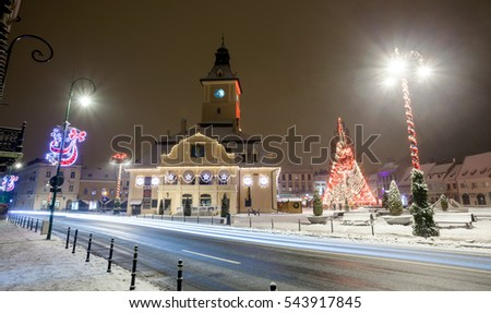 BRASOV, ROMANIA - 15 DECEMBER 2016: Brasov Council House night view with Christmas Tree decorated and traditional winter market in the old town center, Romania