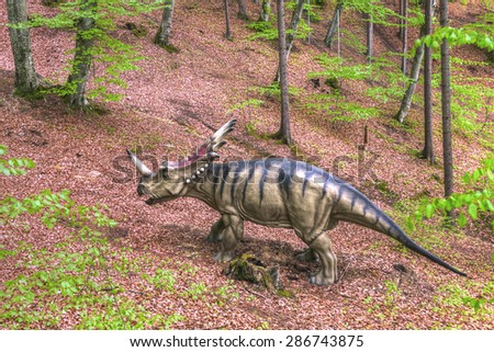 BRASOV, ROMANIA - JUNE 2015: Real-sized dinosaurs at Rasnov Dino Park, Brasov, Romania on June 2015.  The park recreates the lost world of dinosaurs.