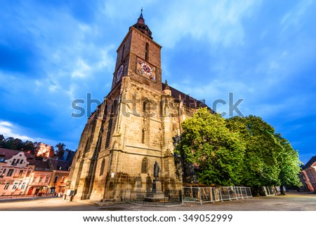 Brasov, Romania. Night image of Black Church built in medieval times in Council Square in downtown of Brasov, Transylvania. - stock photo