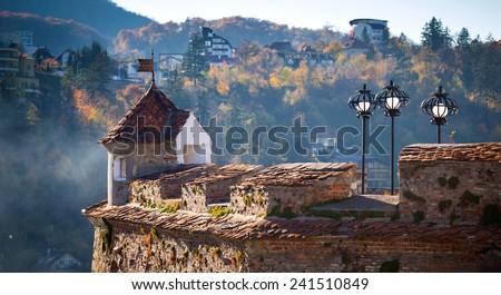 "Brasov, Romania - November 7, 2012: Detail of old fortress ""Cetatuia"" on a sunny autumn day, Brasov, Romania - stock photo"