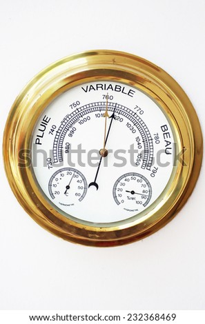 Brass Barometer, Thermometer, Hygrometer with White Face - stock photo