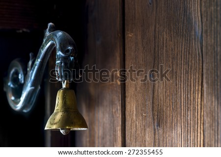 brass bell at the door to the old style - stock photo