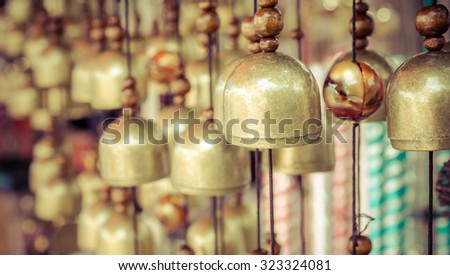 Brass Bells in the temple, Selective focus and vintage color effect - stock photo
