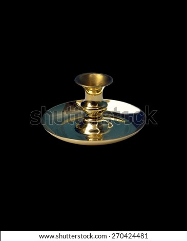 brass candlestick on a black background - stock photo