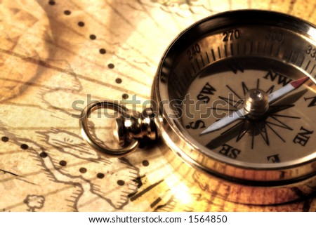 Brass Compass on a Map - stock photo
