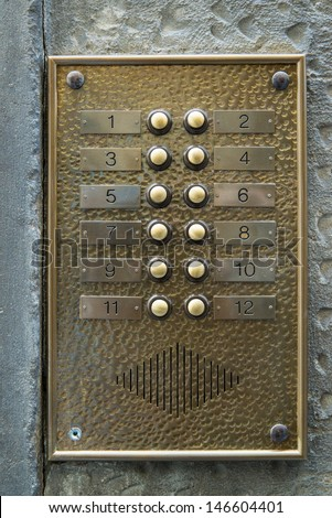 Brass doorbell. Florence. Italy. - stock photo