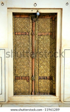 Brass gate of the church in India - stock photo