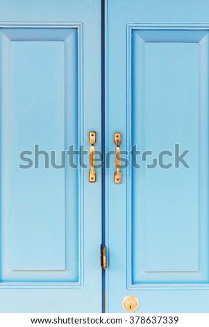 brass handle with blue door - stock photo