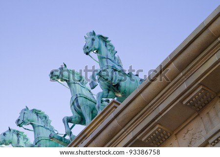 Brass horses over neoclassical ceiling - stock photo