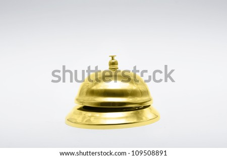 Brass Hotel Service Bell Sitting On Copyspace Desk In A Depiction Of Gold Class or 1st Class Service - stock photo