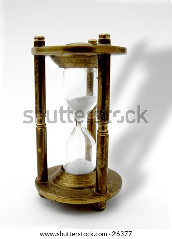 Brass Hour Glass isolated on white background with shadow