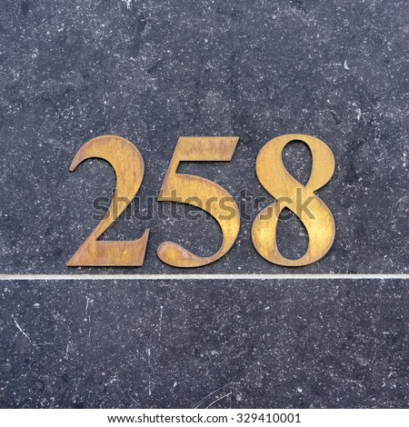 Brass house number two hundred and fifty eight (258) - stock photo