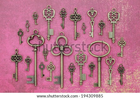 Brass keys of various designs arranged to be shown off. - stock photo