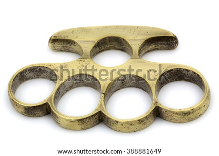 Brass knuckle-duster, weapon for hand, isolated on white background - stock photo