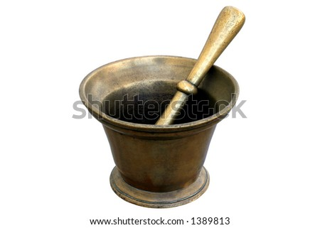 Brass Medicinal Mortar and Pestle - used daily in a French pharmacy.  The aging is real. - stock photo