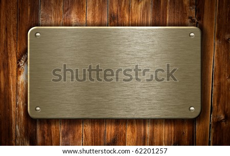 brass metal plate on wooden background - stock photo