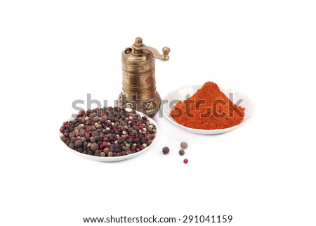 Brass pepper mill and spices isolated on white background - stock photo