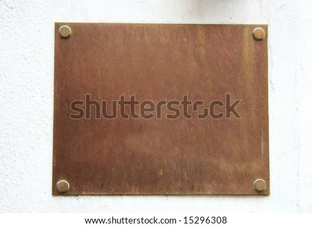 brass plate on white wall - stock photo