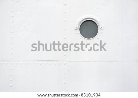 Brass porthole - stock photo