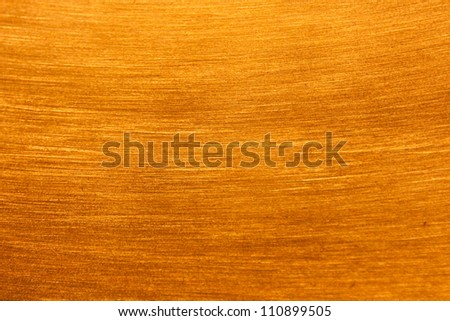 Brass scratched or sanded background texture or wallpaper - stock photo