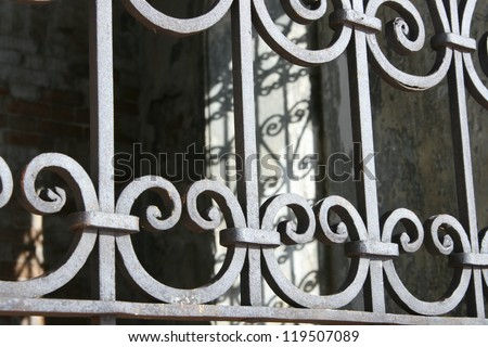 Brass security window ornamentation diminishing - stock photo