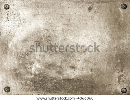 Brass shiny metal plate with screws background texture - stock photo