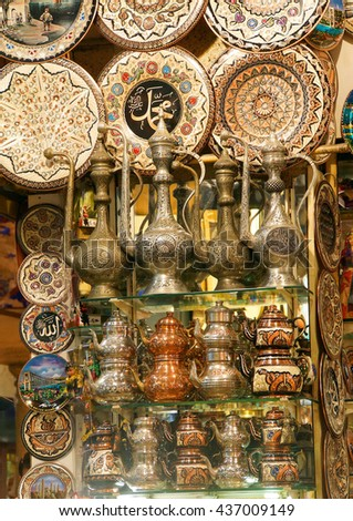 Brass tea sets and serving platters in the Grand Bazaar (Kapali carsi ) in Istanbul, Turkey - stock photo