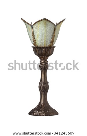 Brass victorian styled lamp with white glass on a white background