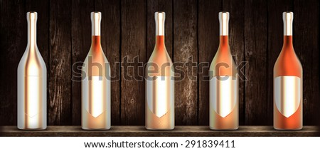 brass wine bottles in a row front of wooden background