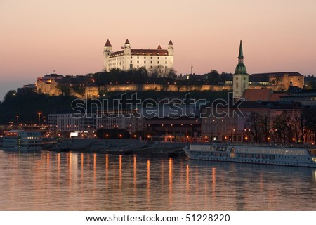 Bratislava castle above Danube river at dusk, Slovakia - stock photo