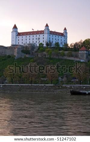 Bratislava castle above Danube river at dusk, Slovakia - stock photo