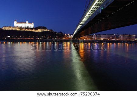 Bratislava castle and bridge at twilght - stock photo