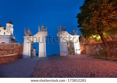 Bratislava castle gates in the evening dusk light, Slovakia, Eastern Europe - stock photo