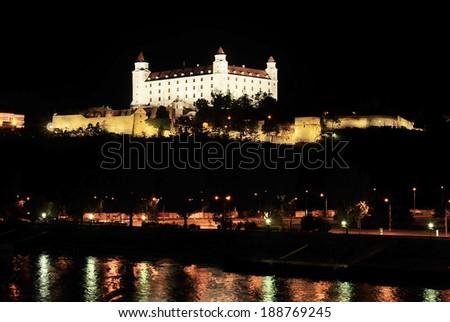 Bratislava Castle with reflection in Danube river, Slovakia - stock photo