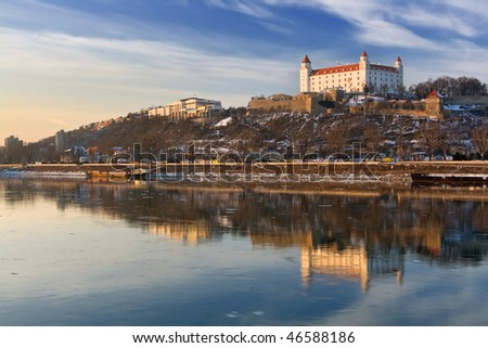 Bratislava castle with reflection in river Danube - stock photo