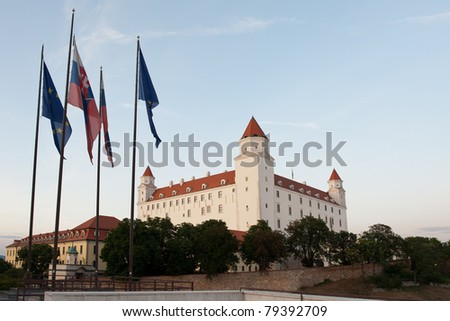 Bratislava castle with Slovak and European Union flags in foreground, Slovakia - stock photo