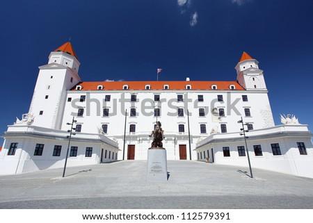 Bratislava castle with statue of King Svatopluk, Slovakia - stock photo