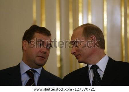 BRATISLAVA - FEBRUARY 25:  Russian president Vladimir Putin, right, speaks with Kremlin chief of staff Dmitry Medvedev in Bratislava, Slovakia, on February 25, 2005. - stock photo