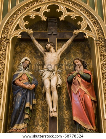 Bratislava - gothic altar from st. Martins cathedral - Christ on the cross and hl. John and hl. Mary - stock photo