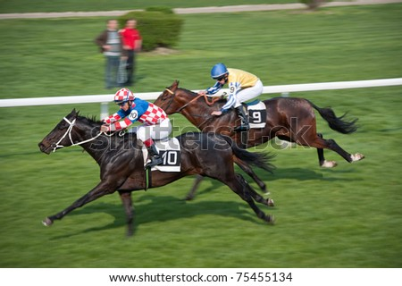 BRATISLAVA, SLOVAKIA - APRIL 17: winner of Bratislava city Mayor Race - TUTANHAMON (GB) #10 ridden by S. Georgjev, ENDLESS STORM (GER)   #9 second on April 17, 2011 in Bratislava, Slovakia