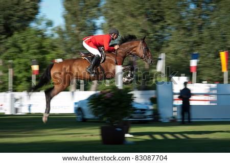 BRATISLAVA, SLOVAKIA - AUGUST 13: Asparuh Atanasov on horse Jessika de Bois jumps over hurdle during 6 bar competition at Grand Prix Bratislava on August 13, 2011 in Bratislava, Slovakia - stock photo