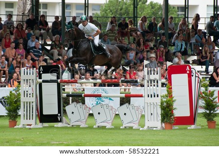 BRATISLAVA, SLOVAKIA - AUGUST 5:  ATZM?LLER Matthias on horse TAMINA 9 on in action during first round of qualification to Grand Prix CSIO-W*** August 5, 2010 in Bratislava, Slovakia - stock photo