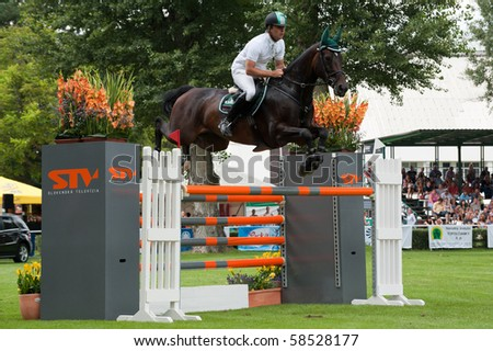 BRATISLAVA, SLOVAKIA - AUGUST 5:  ATZMULLER Matthias on horse TAMINA 9 on in action during first round of qualification to Grand Prix CSIO-W*** August 5, 2010 in Bratislava, Slovakia - stock photo