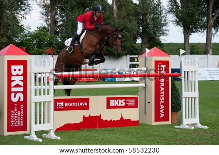 BRATISLAVA, SLOVAKIA - AUGUST 5:  CIGAN Jan on horse LAVAI in action during first round of qualification to Grand Prix CSIO-W*** August 5, 2010 in Bratislava, Slovakia - stock photo