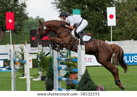 BRATISLAVA, SLOVAKIA - AUGUST 5: GLOSKOWSKI Andrzej on horse IMEQUYL in action during first round of qualification to Grand Prix CSIO-W*** August 5, 2010 in Bratislava, Slovakia - stock photo