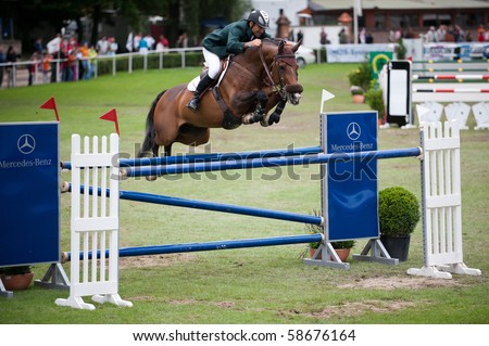 BRATISLAVA, SLOVAKIA - AUGUST 7: LUYCKX Charles on horse OLIBERO in action during the third round of qualification to Grand Prix CSIO-W*** August 7, 2010 in Bratislava, Slovakia - stock photo
