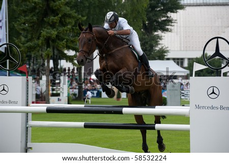 BRATISLAVA, SLOVAKIA - AUGUST 5: Participant in action during first round of qualification to Grand Prix CSIO-W*** August 5, 2010 in Bratislava, Slovakia - stock photo