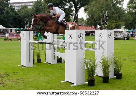 BRATISLAVA, SLOVAKIA - AUGUST 5: RAISCH Matthias on horse COMMANDER 5 in action during first round of qualification to Grand Prix CSIO-W*** August 5, 2010 in Bratislava, Slovakia - stock photo