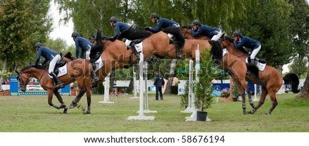 BRATISLAVA, SLOVAKIA - AUGUST 7: study of jump over hurdle - HUFENSTUHL Alexander on horse CAMSEY during the third round of qualification to Grand Prix CSIO-W*** August 7, 2010 in Bratislava, Slovakia - stock photo